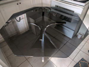 Glass table with 5 chairs