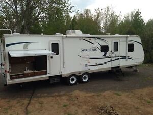 2013 Venture Sport Trek travel trailer (2 slides and bunks)