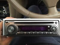 Kenwood stereo with cage, surround and iso leads