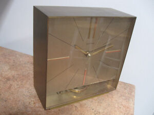 Electro mechanical brass mantle clock