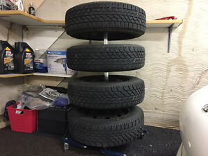 Goodyear Ultragrip tires on steel rims with storage rack