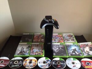Selling Xbox 360 slim comes with tons of games, controller, more