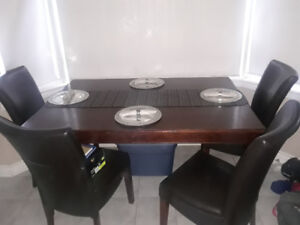 SEATS 8! Large wood table with a hidden leaf w/ 4 Parsons chairs