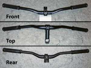 Mountain bike handle bars and riser. Great condition!