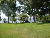 Grand Lake WATERFRONT! incl. House & 15+/- Acres!