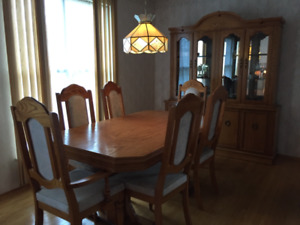 Dining room table with hutch.... and matching sofa set