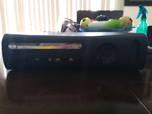 Xbox 360/250 storage/ 2 controllers one wired one not  4 games