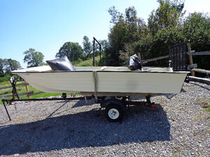 Stable 14 foot fiberglass boat and trailer