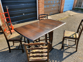 Drop leaf table and 4 chairs can deliver