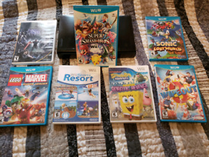 WiiU with Pad, controller AND 7 games!!!!