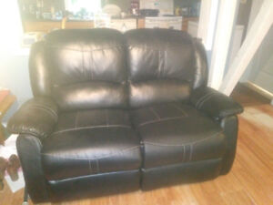 Black leather recliner sofa and love seat.