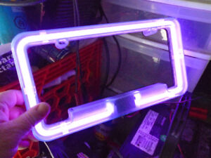 Neon licence plate surround.
