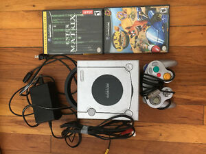 Box of video games, consoles and accessories