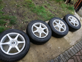 SET OF 16 INCHES ALLOY WHEELS WITH DECENT CONDITION DUNLOP TYRES