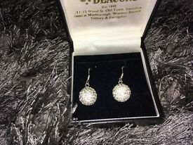 Real silver earrings from deacons. Boxed