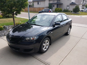 2005 Mazda 3 with winter tires and rims (lady driven)