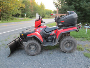 Polaris ATV with Plow