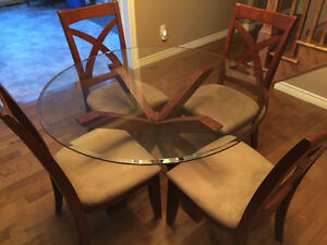 Round glass dining table with 4 chairs and matching coffee table