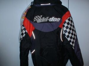 Like new ski doo jacket and brand new hat ( baseball type )