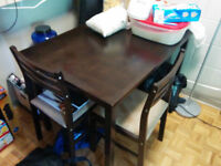 Dark wood dining table + 4 chairs