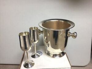 Silver plated Ice bucket with silver flutes.  30 Years old.