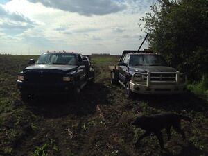 2002 Dodge Sport welding truck and 2000 Dodge with flood deck