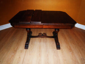 Solid wood antique dining room table with two leaves