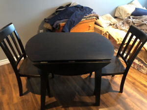 Drop leaf kitchen table with 2 chairs. Paid $500. Asking $150