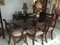 Georgian style dining table and 6 chairs.