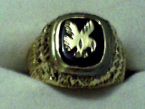 1O KT. GOLD EAGLE RING WITH BLACK ONYX