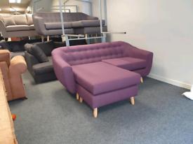 Brand new ex display corner group sofa in a purple fabric £375