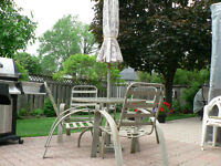 Patio set: table - 4 chairs and umbrella