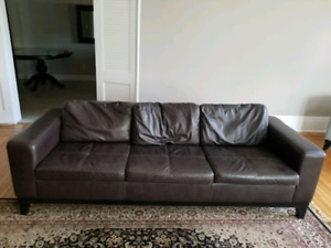 Chocolate brown leather sofas, chair, ottoman and coffee table