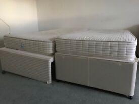 FREE Two single divan beds