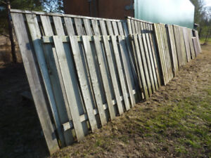 Used pressure treated wooden fence panels and planks. Various si