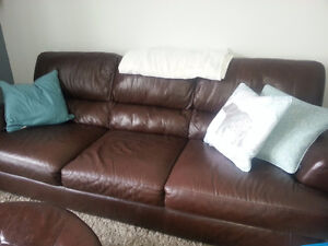 7 foot Natuzzi Leather Sofa w/ ottoman and throw pillows