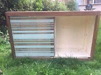 Cabinet with sliding glass door