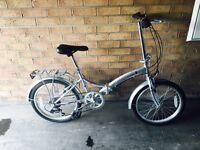 Unisex fold up bike. Used once!!! Like new!!