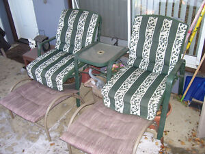 2-seater outdoor seat (table in middle) with footrests.
