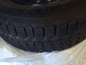 4 gently used snow tires with rims for sale