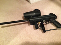 Tippmann A5 paintball marker w/ extras. Barely used.