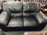 2 as new black leather 2 seater sofas