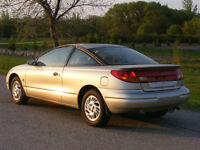 1999  Saturn  coupe  Loaded  Nifty 5 speed gas saver 164,000 kms