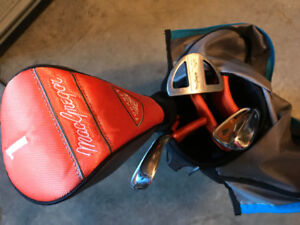 Youth left golf clubs and bag