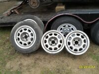 89 mustang lx 5.0L rims.set of 4 with caps,and headers,