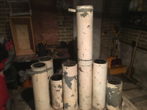 several lengths of used chimney pipes