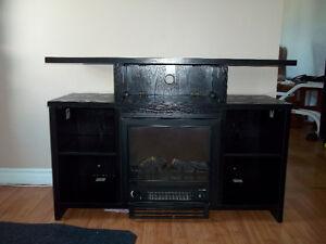 Meuble de télé avec foyer électrique noir en très bonne état