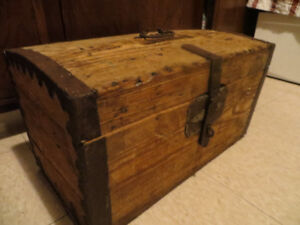 Small wooden chest with tools
