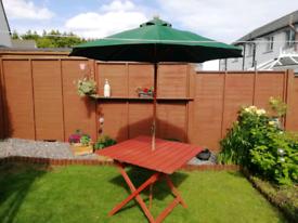 Garden table & parasol (pending collection)