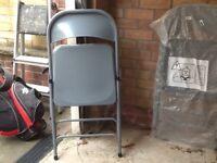 Grey folding chairs